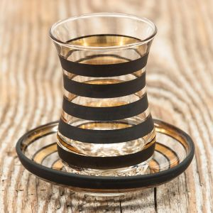 Teeglas gold-schwarz