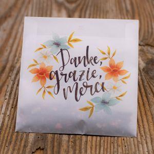 «Danke Grazie Merci» in Pergament Couvert